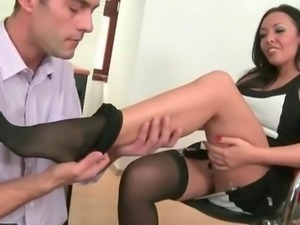 Exotic beauty enjoys footsex in office