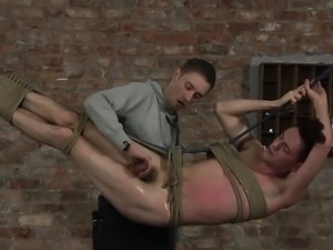 Hanging butt naked Jonah gets abused and spanked by Ashton