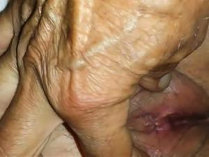 Playing with a horny mature vagina closeup