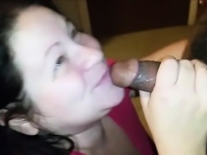 Mature housewife sucks a hairy black cock