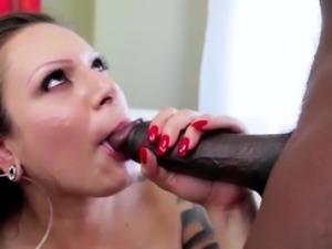 Busty brunette sucks a huge black cock