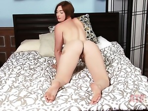 Jodi Taylor with tiny tits touches her jugs playfully