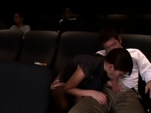 Japanese babe tugging and sucking in cinema