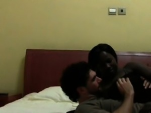 African bitch serving white shaft in a hotel room