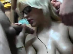Blonde swallows big loads in bukkake orgy