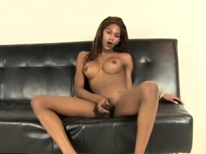 Gorgeous ebony tgirl jerking her uncut dick