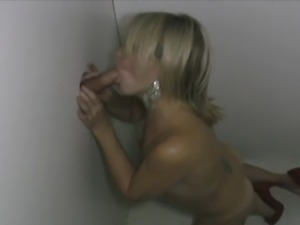 Sexy wife Carly bowing strange men in the Gloryhole