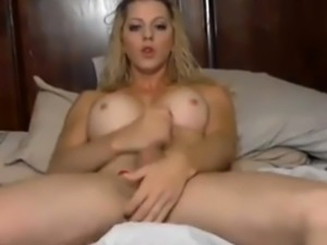 Tranny With a Toy in her Ass cums on her hand