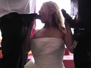 Insatiable blonde bride works her lips and hands on two black shafts