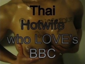 Big breasted Thai housewife loves to suck and fuck a huge black prick