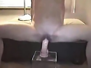 Her dildo is mounted by thin amateur woman with little brea