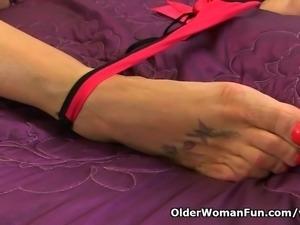 British milf Lulu Lush is wearing fishnet stockings