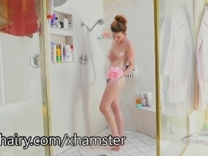 Emma Evins using a shower head to masturbate