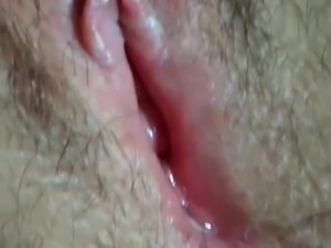 wife fingering hairy pussy and gets an orgasm