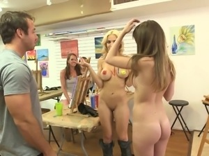 These sexy life models are certainly earning their money at the art class...
