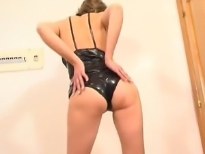 MILF in a leather outfit that comes off
