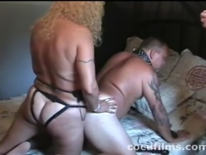 The cuckold fucks his wife with a dildo strapped on his face, to suck her...