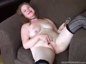 Saucy old spunker in sexy stockings plays with her fat pussy