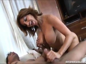 Bodacious cougar Tara Holiday displays her handjob and blowjob skills