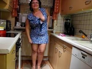An elderly German woman trying striptis
