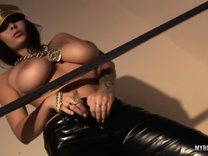 Busty brunette bitch Domino slips out of her leathers to stroke her hot snatch
