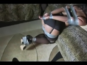 Slave girl tied tight in tape