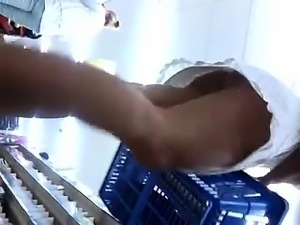 Hot blonde shopper shows a nice ass under her white skirt i