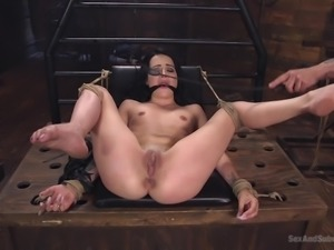 helpless brunette gets bonded and used