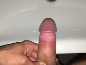 young semi-hard cock pees in the sink