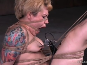 Tattooed girl suffers through sexy bondage in a dungeon