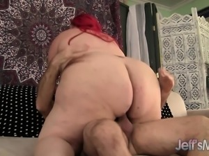 Fat redhead goes for a cock ride and slurps up his long wanker