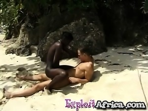 Hot African enjoys white cock at the beach
