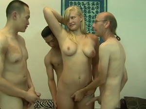 Lusty blondie with yummy boobies Jessica Brandy gets three cocks inside her