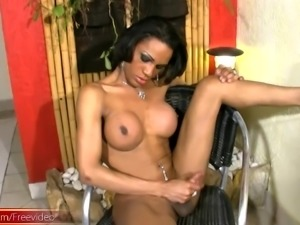 Busty chocolate shemale proudly exhibits all parts of her body