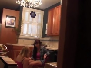 Lesbians fucking in the kitchen