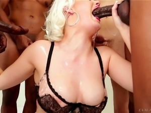Fair haired slut Jenna Ivory deepthroats black and white cocks