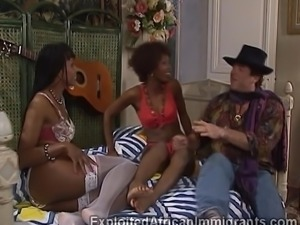 Tow beautiful black groupies give their ass holes for an