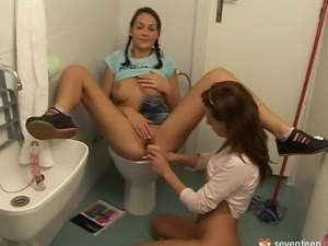 Teen lesbian gets eaten out by Gf while sitting on the toilet