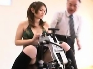 Striking Oriental babe changes clothes and enjoys a mechani