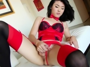 Ladyboy slut strokes cock