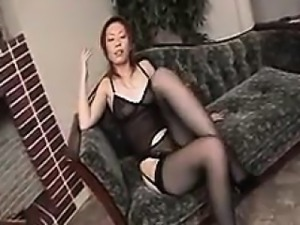 Elegant Oriental babe sensually reveals the contours of her