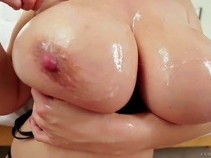 Asian mom Kianna Dior puts her oiled up monster tits on display again. She...