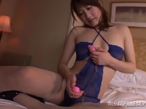 Passionate Asian babe in fishnet stockings riding on a massive dildo in a...