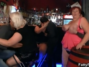 Crazy plump chicks have fun in the bar