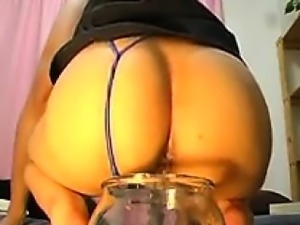 Dirty young chick lets you watch as she poops in a glass ja