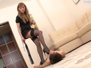 Sassy femdom fetish dame in high heels striping her slave