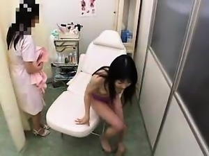 Asian hottie is getting her ass and cunt examined and toyed