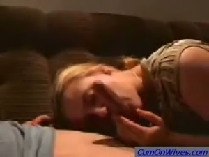 Blonde submissive sexy babe on the sofa gives blowjob and titjob