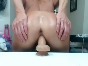 Using a dildo oil covered bright blond head was petting her own pussy