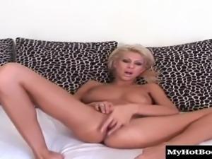 Ravishing blonde babe stuffs toys in her twat before fisting it